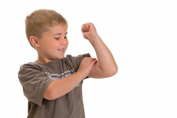 Proud boy feeling his muscle