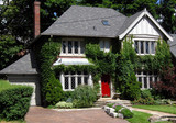 Two storey house with red door, ivy, leaded glass poster