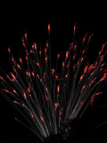 Fountain firework with red flames at the streamer tips poster