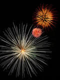 Three fireworks bursts in red-gold, pink, and white poster
