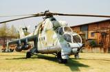 Soviet era military helicopter in farm backyard poster