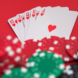 Royal flush & casino chips on red - shallow dof poster