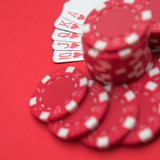 Royal flush on red with red chips - shallow depth of field poster