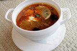 Russian solyanka - spicy soup of vegetables and meat with lemon poster