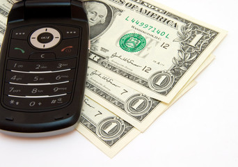Mobile phone and dollars on white