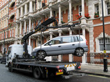 Illegally parked car being removed by police, London poster