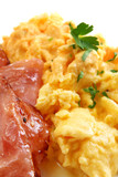 Scrambled eggs and bacon, with parsley.   poster