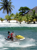 Racing on jetskier during vacation on tropical island poster