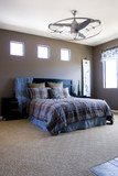 Modern tastefully decorated master bedroom poster