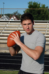 A young man throwing a football on the ball field