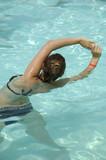 Girl in pool doing aerobic poster