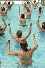 People doing aerobic in a swimming pool