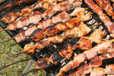 barbecue with delicious grilled meat on grill poster