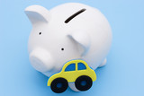 A piggy bank for the saving or loan for a car poster