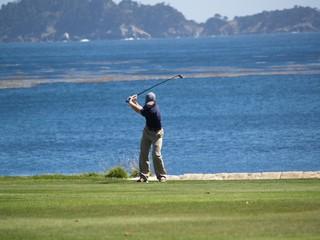 Golfer, firing away.