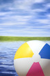 beach ball river background, focus point on the toy