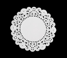 A decorative round doily isolated over black