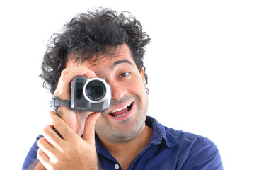 Man holding a camcorder and making a video.
