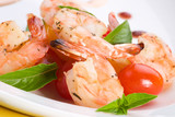 spicy grilled shrimps and basil tomato salad served. poster
