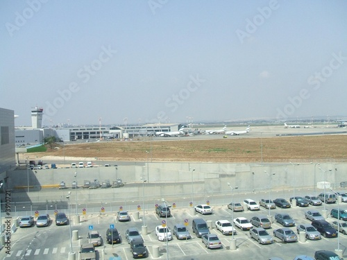 cars in parking lot in an airport
