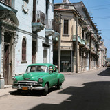the car is parked in old havana downtown-