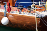 detail from luxurius wooden sailing yacht at marina 2