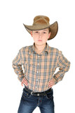 Country boy dressed in check shirt, denim jeans, and hat poster