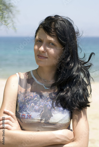 pretty young woman smiling thoughtful greek island beach