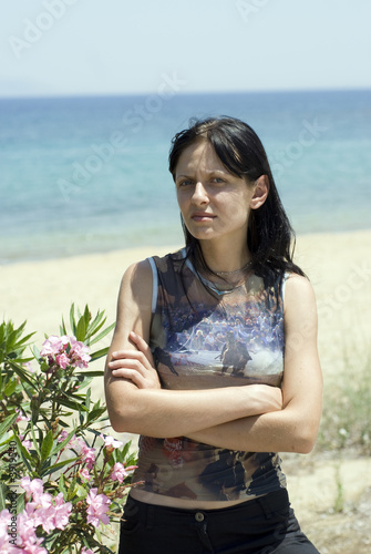 pretty young woman with emotional attitude on beach