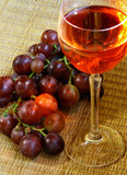 Red wine, grapes and sunlight poster