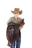 Country boy carrying a saddle poster
