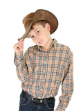 Child wearing a check shirt, denim jeans and a cowboy hat. poster
