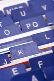Close up of desktop business card index holder. poster