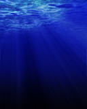 Sunlight shining through dark blue water poster