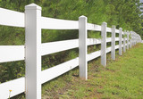 A decorative white split rail fence. poster
