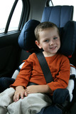 little boy in car safety seat poster