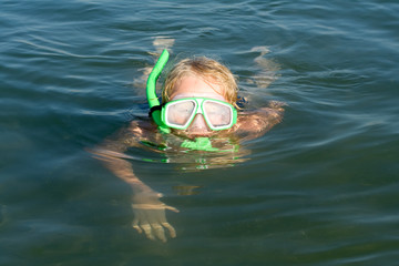 Boy with diving mask and snorkel