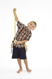 Young caucasian boy dressed in a carpenter outfit standing poster