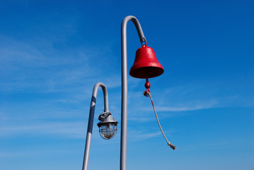 Red ship bell and lamp