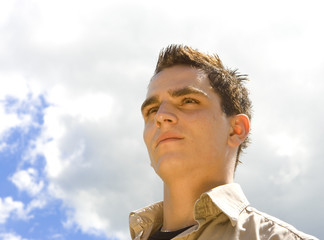 Head and Shoulders of Young Man Against Sky