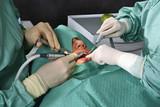 Dentist at work in dental room poster