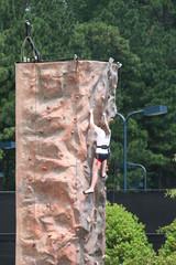 Woman Climbing Wall