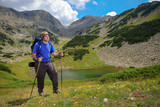 Hiker climbing a peak at NP Pirin, Bulgaria poster
