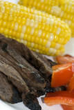 skirt steak with corn and red peppers poster