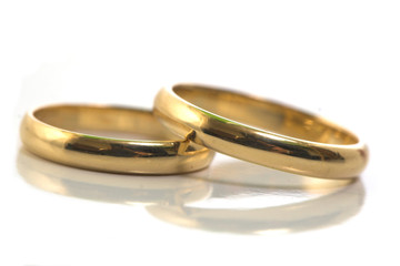 Gold wedding rings isolated on white