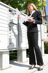 Business Woman Getting Mail