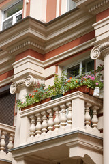 The balcony decorated by flowers