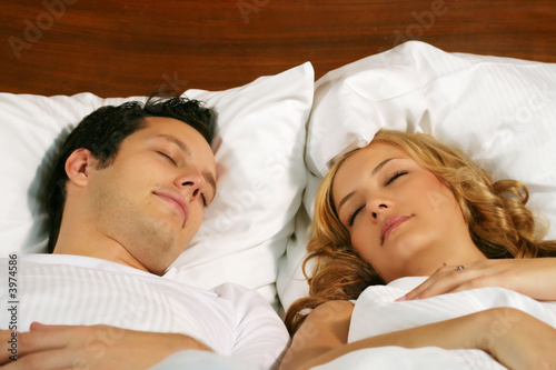 sleeping young couple