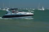 Motor cruiser at sea poster