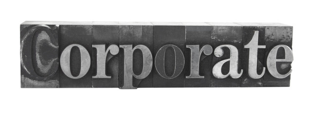 the word 'corporate' in old, inkstained letterpress metal type
